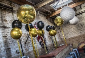 black and gold orbz balloons