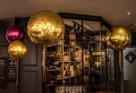 Giant gold metallic confetti balloons